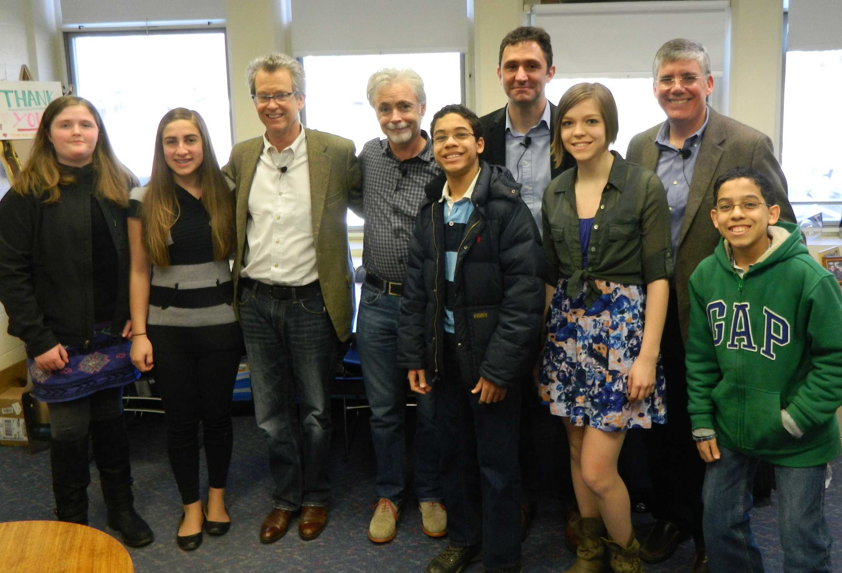 Authors (back row, right to left), Rick Riordan, Jonathan Stroud, Eoin Colfer,and Ridley Pearson pose with student reporters from the Watertown Public Schools at the one-time-only