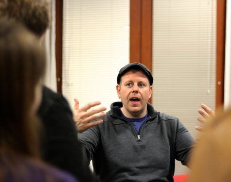 Mike Snow, founder of the Boston Calling Music Festival, talks with journalism students from Boston-area high schools during a music panel at the Boston Globe.
