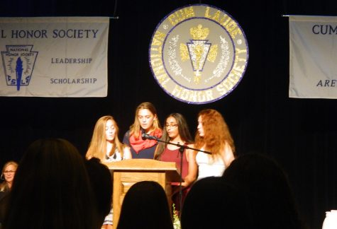 The executive officers of Watertown High's National Honor Society (from left) Alexis Catsoulis, Stella Varnum, Janaki Thangaraj, and Sarah Greim, speak during induction ceremonies Oct. 20, 2016.