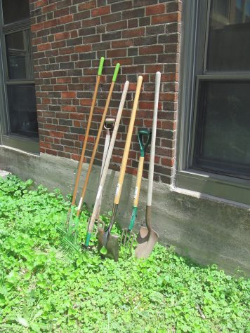Gardening tools take a break in the Watertown High School courtyard in the spring.