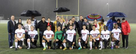 The senior members of the Watertown High boys' soccer team pose with their families during Senior Night festivities, Oct. 21, 2016, at Victory Field.