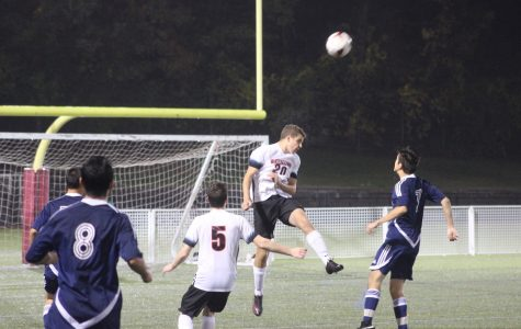 Alex Abrahamyan (20) heads a ball away during Watertown High School's 4-0 win over Wilmington at Victory Field on Oct. 21, 2016.