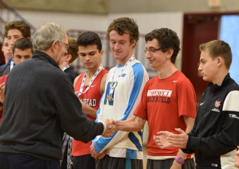 Watertown High senior James Piccirilli accepts his medal after finishing eighth in the MIAA state Division 2 cross-country championships on Nov. 19, 2016, in Gardner. Piccirilli finished the 5K course in 16 minutes 51 seconds.