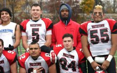 Bryan Canales (55) and Gautam Mannan (62) pose after Watertown defeated host Belmont, 34-28, in their annual Thanksgiving game on Nov. 24, 2016.