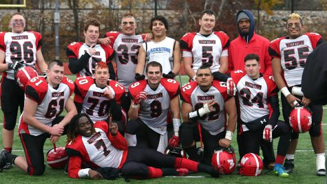 The victorious Raiders pose after Watertown defeated host Belmont, 34-28, in their annual Thanksgiving game on Nov. 24, 2016.