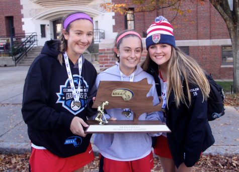 Members of the Watertown field hockey team pose outside the high school with the MIAA Division 2 trophy Nov. 19, 2016. The Raiders defeated Oakmont, 4-3, to win their eighth straight state championship.