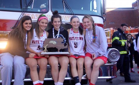 Members of the Watertown High School field hockey team pose with the MIAA Division 2 state title on Nov. 19, 2016. The Raiders defeated Oakmont, 4-3, at WPI for their eighth straight state championship.