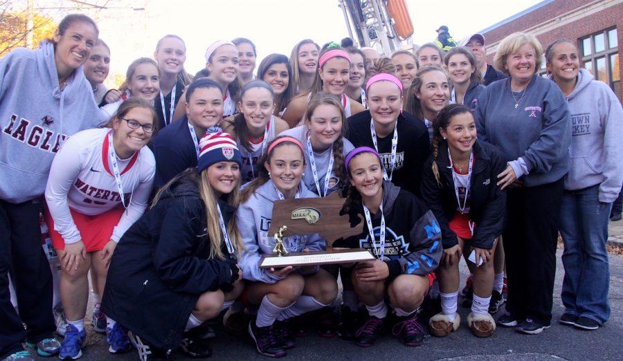 The+Watertown+High+School+field+hockey+team+poses+with+the+MIAA+Division+2+state+title+on+Nov.+19%2C+2016.+The+Raiders+defeated+Oakmont%2C+4-3%2C+at+WPI+for+their+eighth+straight+state+championship.