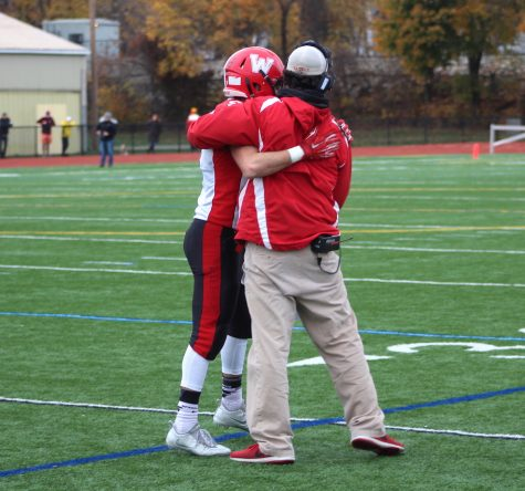 Coach John Cacace (right) congratulates Vasken Kebabjian, who scored three touchdowns run during Watertown's 34-28 victory at Thanksgiving rival Belmont on Nov. 24, 2016.