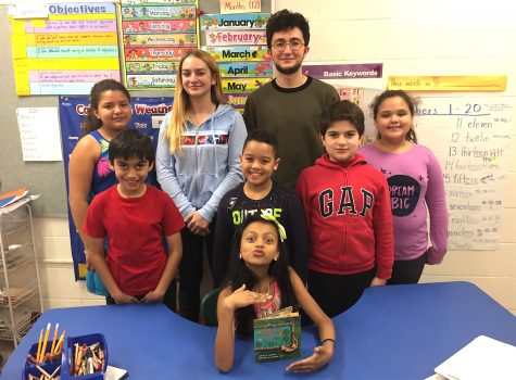 Students from Watertown High School (standing center) volunteer with STAR program for ELL students at Cunniff Elementary School in Watertown, Mass.