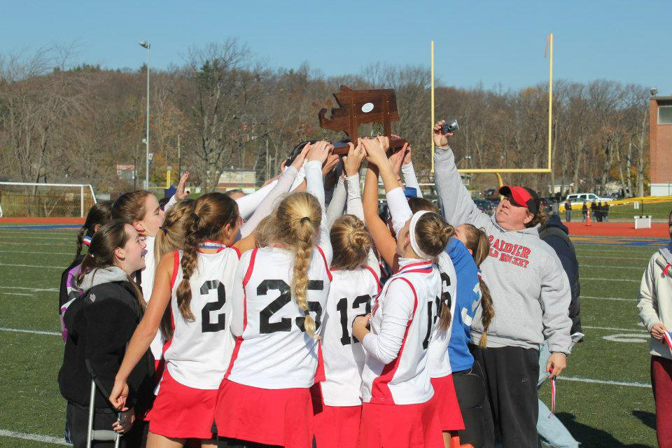 Field+hockey+players+celebrate+their+State+Championship+after+beating+Oakmont.
