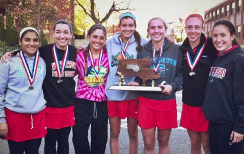 Some members of the Watertown field hockey team pose with the Division 2 state title trophy.