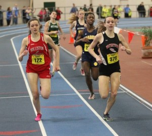 Holliston's Sydney Snow (left) and Watertown's Lea Strangio battle down the stretch in the 600 at the Division 4 state indoor track championships Sunday, Feb. 16, 2014, at the Reggie Lewis Center.