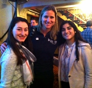 Four-time Olympic medalist Angela Ruggerio (center) poses with student reporters from Watertown representing the Raider Times at the Countdown to Sochi panel discussion at the Park Plaza Hotel in Boston on Jan. 10, 2014.