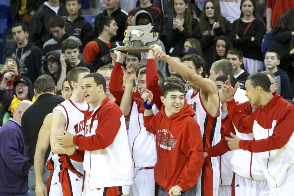The+Watertown+High+boys%27+basketball+team+celebrates+its+Division+3+North+title+after+defeating+Stoneham%2C+48-34%2C+on+Saturday%2C+March+8%2C+at+Tsongas+Center+in+Lowell.