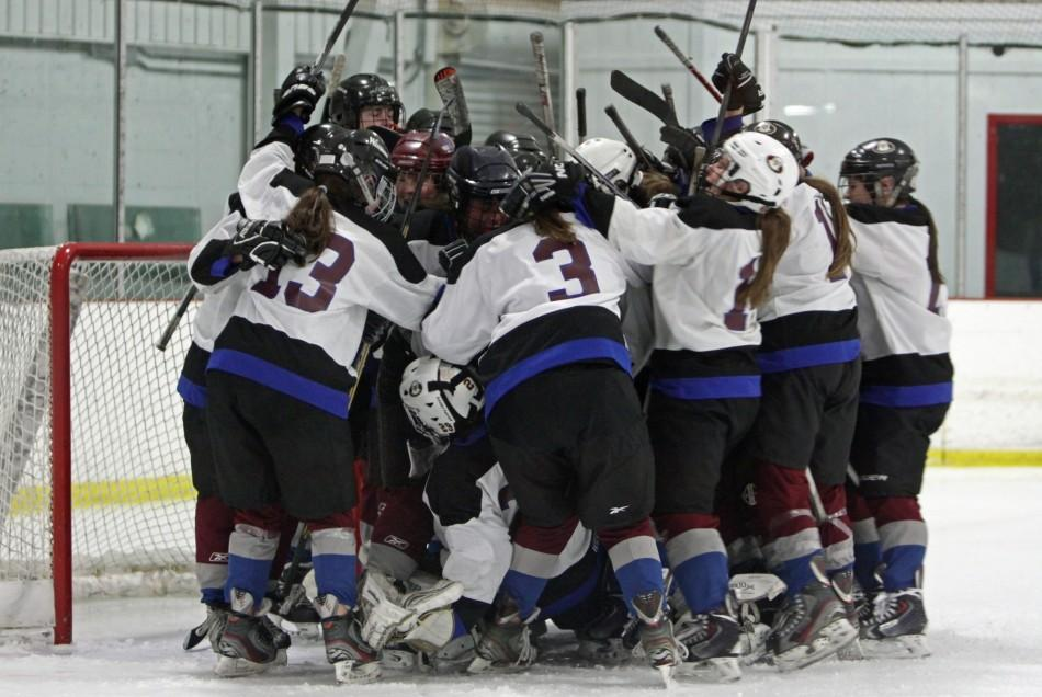 The+Maraiders+celebrate+their+3-2+victory+over+Andover+in+an+Division+1+girls%27+hockey+game+Saturday%2C+March+1%2C+2014%2C+at+Ryan+Arena+in+Watertown.++Watertown-Belmont+%2817-2-2%29+advances+to+play+Duxbury+%2814-1-6%29+on+Wednesday%2C+March+5%2C+at+Stoneham+Arena.