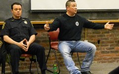 Sergeant John MacLellan (right)  talks about the events of April 19, 2013, during a visit to Watertown High School on March 10, 2014.  Watertown Police Lieutenant James O'Connor is at left.
