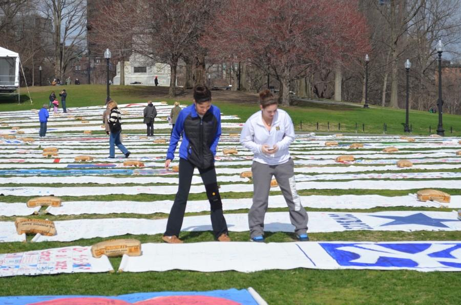 Prayer canvases from around the country, including one decorated by Watertown High School students, cover the Boston Common during Patriots Day weekend. The canvases were made in a response to the 2013 Boston Marathon bombings.