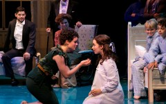 Peter Pan (Melanie Moore) and Wendy (Emma Pfaeffle) share a kiss in the production of the musical