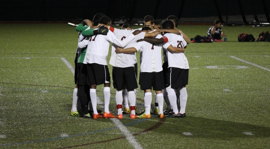 The+Watertown+High+boys%27+soccer+team+huddles+before+the+start+of+its+game+with+Stoneham+on+Monday%2C+Sept.+22%2C+2014.