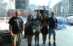 Boston Calling Music Festival founders Mike Snow (left) and Brian Appel (right) pose with Raider Times reporters from the front of the JetBlue stage where The National, Childish Gambino, and Nas and The Roots will be performing this weekend. (Sept. 3, 2014)