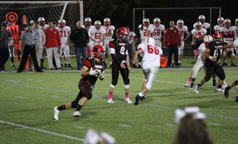 Austin Farry (left) and Nick Girodano (8) had the Melrose defense running every which way during Watertown's 28-26 victory on Oct. 10, 2014, on Senior Night at Victory Field.
