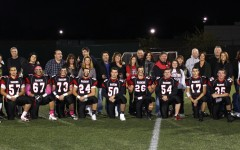 The seniors on the Watertown High School football team and their families pose on Victory Field prior to their last regular-season home game, a 28-26 victory over Melrose on Oct. 10, 2014.