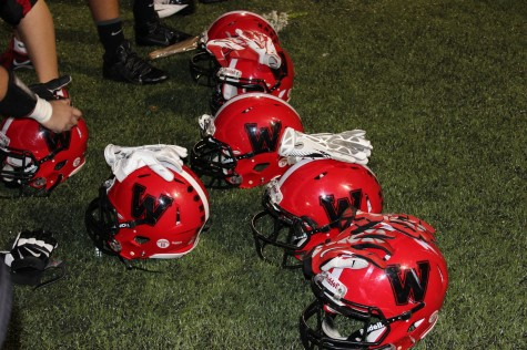 Gear awaits the Watertown High School football team prior to its Senior Night game with Melrose on Oct. 10, 2014.