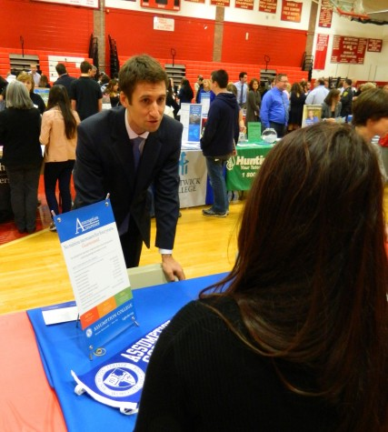 Alphabetically speaking, the Assumption College table was one of the first stops for prospective applicants at the Watertown High School College Fair on Oct. 9, 2014.