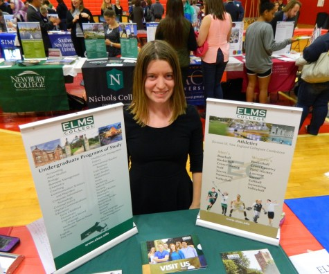 Kate Kelly, admissions counselor at Elms College, at the annual College Fair at Watertown High School on Oct. 9, 2014.