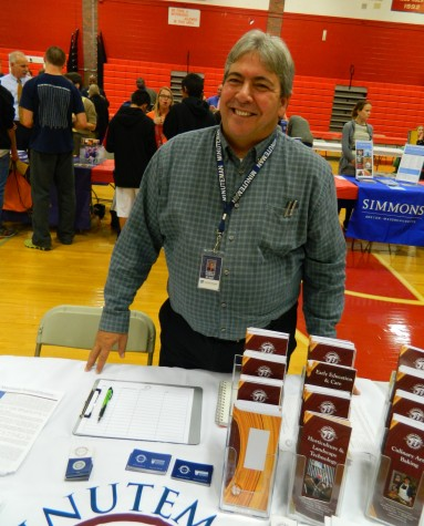Ron Marino representing Minuteman Technical Institute at the annual College Fair at Watertown High School on Oct. 9, 2014.