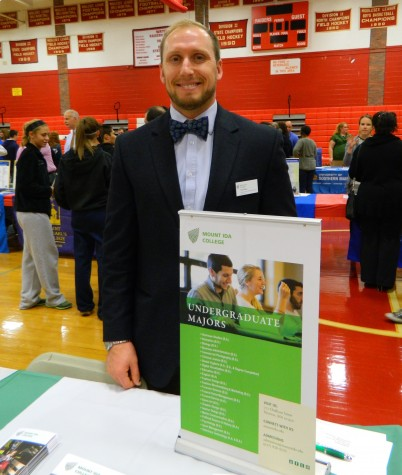 Luke Wilson representing Mount Ida at the Watertown High College Fair on Oct. 9, 2014.
