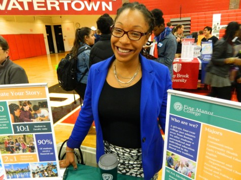 Shary Browne representing Pine Manor College at the Watertown High School's annual College Fair on Oct. 9, 2014.