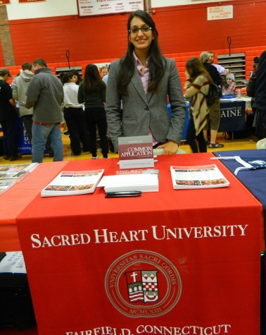 Shivani Sood representing Sacred Heart University at the annual College Fair at Watertown High School on Oct. 9, 2014.