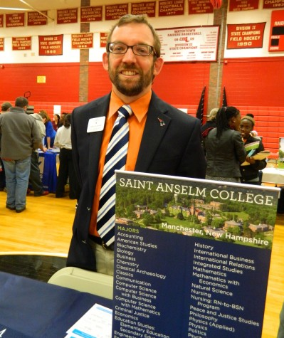 Daniel Richer representing Saint Anselm College at the annual College Fair at Watertown High School on Oct. 9, 2014.