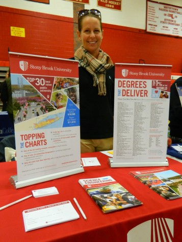 Amanda Mills representing Stony Brook University at the annual College Fair at Watertown High School on Oct. 9, 2014.