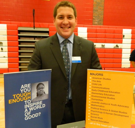 Eric Small representing Wheelock College at the annual College Fair at Watertown High School on Oct. 9, 2014.