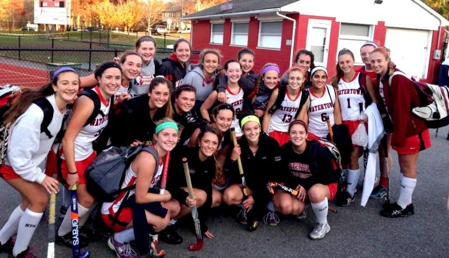 The+2014+Watertown+field+hockey+team+poses+after+capturing+the+Division+2+Eastern+Mass.+title+with+a+4-0+defeat+of+Dover-Sherborn+on+Nov.+11%2C+2014%2C+at+Reading+High.