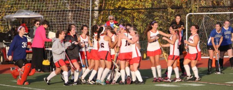 The 2014 Watertown field hockey team celebrates after capturing the Division 2 Eastern Mass. title with a 4-0 defeat of Dover-Sherborn on Nov. 11, 2014, at Reading High.