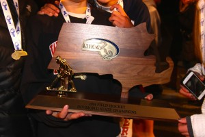The 2014 Division 2 state field hockey trophy is brought back to Watertown by the Raiders field hockey team on Sunday night, Nov. 16, 2014. The Raiders defeated Auburn, 5-0, to complete their season 23-0 and extend their unbeaten streak to 138 games.