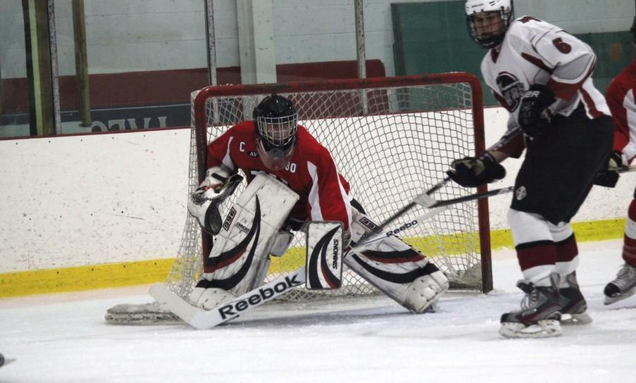 Watertown senior goalie Anthony Busconi made 41 saves Wednesday, Dec. 17, 2014, in the Raiders' 3-0 season-opening loss to Arlington at Ryan Arena.