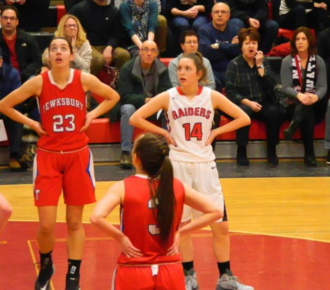 Gianna Coppola (14) and the rest of the Watertown High girls' basketball team had a hard time with Tewksbury and forward Molly Robertson (23) during their Division 2 North game on Thursday, Feb. 26, 2015. The undefeated Raiders won, 49-45, to advance to the sectional semifinals against Belmont on Tuesday, March 3, at Mystic Valley High in Malden.