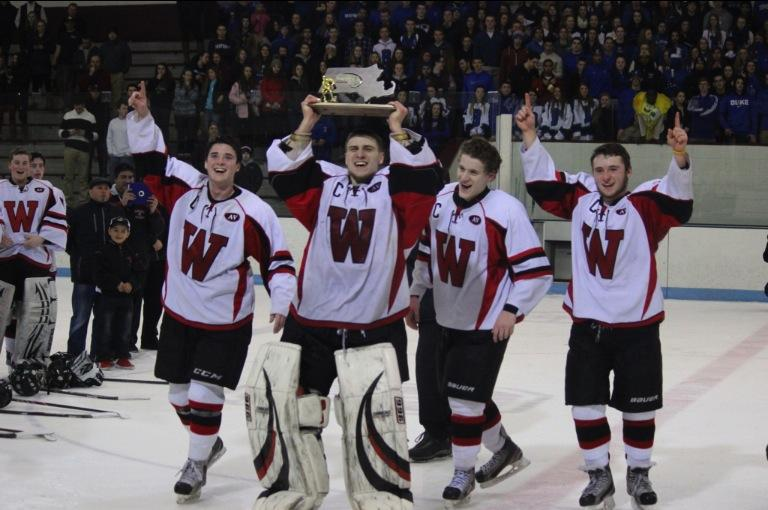 Watertown High senior captains (from left) Brendan Berkeley, Anthony Busconi, Nick Giordano, and Austin Farry celebrate the Raiders' first Division 3 North championship after their 2-1 victory over Bedford at Chelmsford Arena in Billerica on Friday, March 6, 2015.