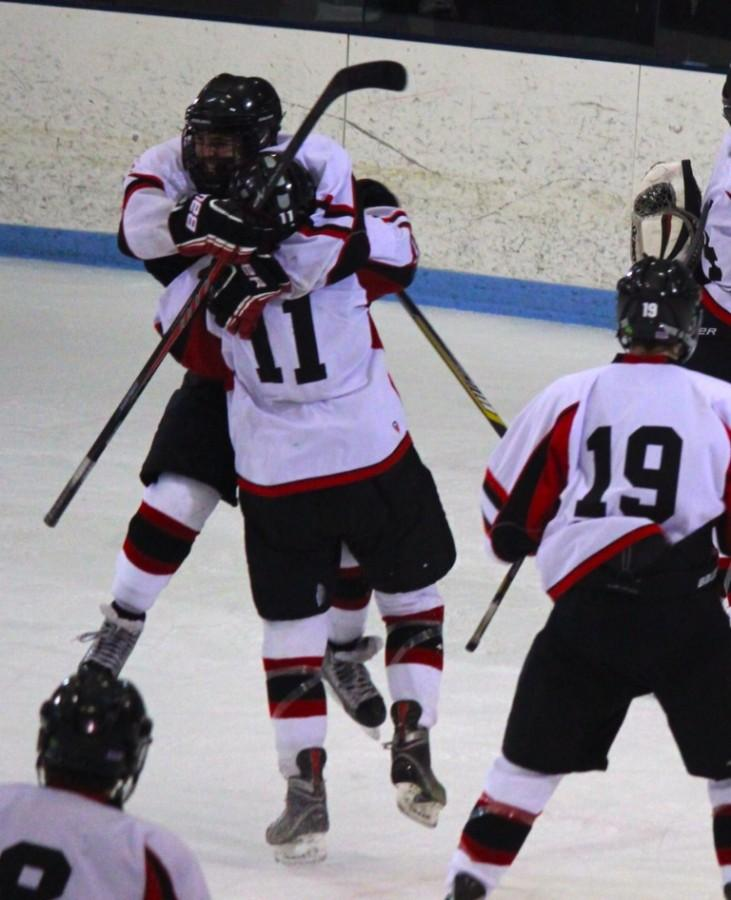 Brendan Berkeley (11) and Austin Farry celebrate Watertown's 2-1 victory over Bedford in the Division 3 North title game at Chelmsford Arena in Billerica on Friday, March 6, 2015. Fellow senior Matt Murphy joins the celebration at right.