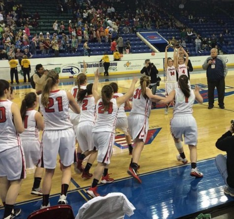 The Watertown girls' basketball team rushes the court to celebrate with seniors Gianna Coppola (14) and Rachel Morris (4)  after the Raiders won the Division 2 North championship at Tsongas Center in Lowell on Saturday, March 7, 2015. Watertown beat Pentucket, 44-40, to advance to the MIAA's Eastern Mass. title game against undefeated Duxbury on Tuesday, March 10, at TD Garden.