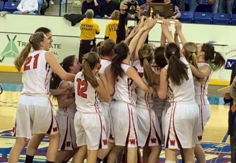 The Watertown girls' basketball team celebrates their Division 2 North championship at Tsongas Center in Lowell on Saturday, March 7, 2015. Watertown defeated Pentucket, 44-40, to advance to the MIAA's Eastern Mass. title game against undefeated Duxbury on Tuesday, March 10, at TD Garden.