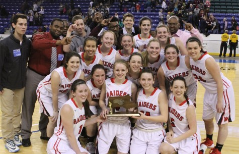 The Watertown girls' basketball team poses with the MIAA Division 2 North championship trophy at Tsongas Center in Lowell on Saturday, March 7, 2015. The Raiders beat Pentucket, 44-40, to advance to the Eastern Mass. title game against Duxbury on Tuesday, March 10, at TD Garden.
