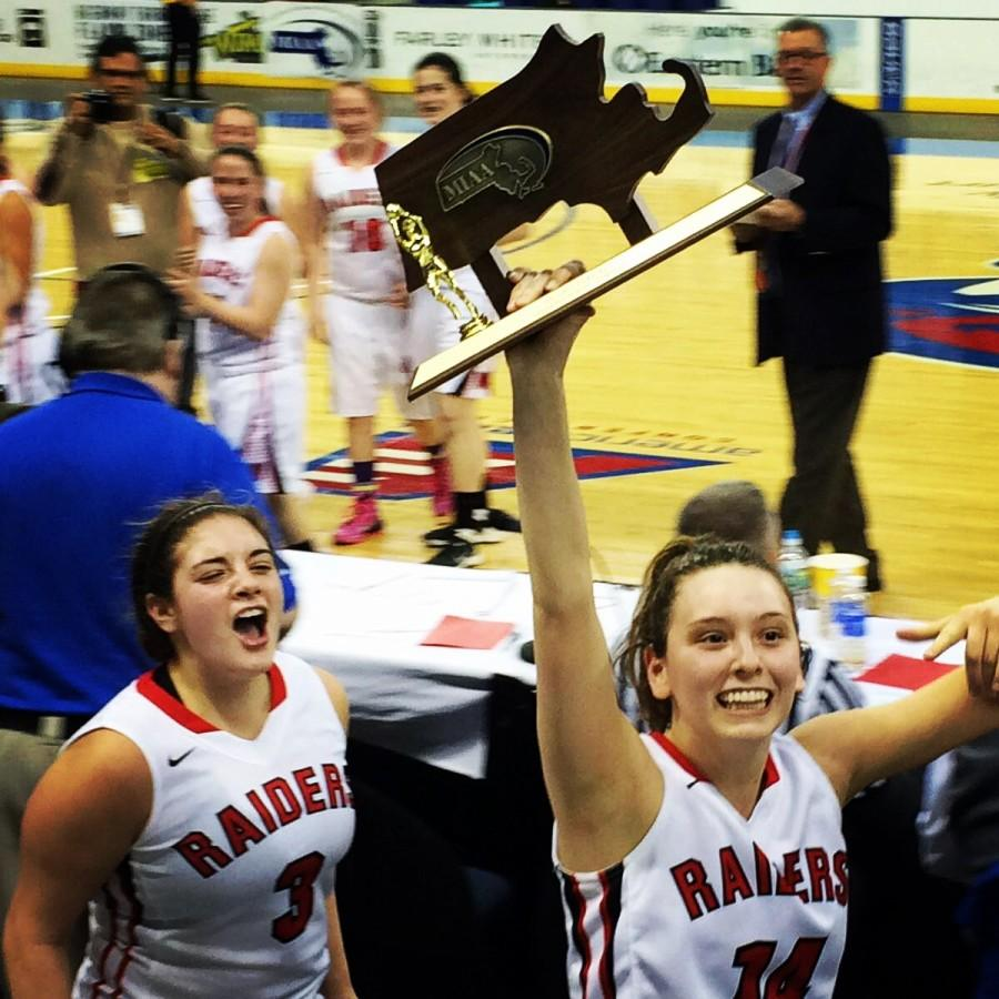 Michael Antonellis (left) and Gianna Coppola celebrate with their hard-earned trophy after the Watertown girls' basketball team won the Division 2 North championship at Tsongas Center in Lowell on Saturday, March 7, 2015. Watertown beat Pentucket, 44-40, to advance to the MIAA's Eastern Mass. title game against undefeated Duxbury on Tuesday, March 10, at TD Garden.