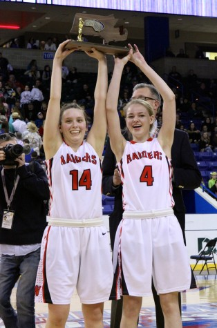 Seniors Gianna Coppola (14) and Rachel Morris (4) hold up the Division 2 North championship trophy at Tsongas Center in Lowell on Saturday, March 7, 2015. Watertown High beat Pentucket, 44-40, to advance to the state semifinal game against undefeated Duxbury on Tuesday, March 10, at TD Garden.