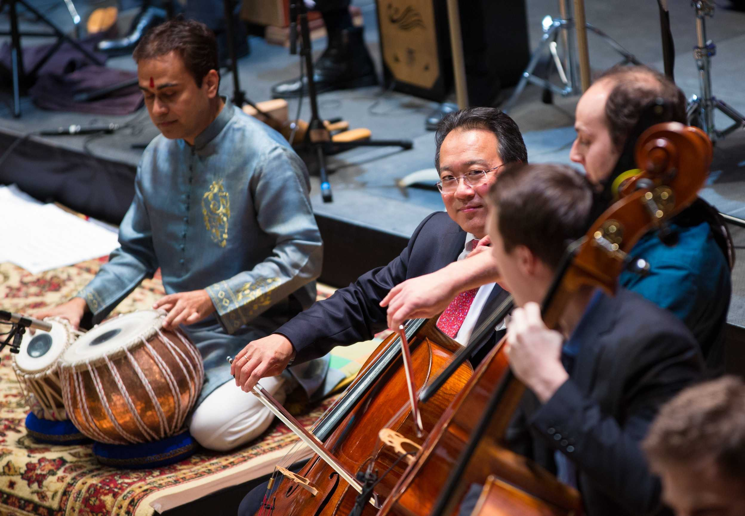 Cellist Yo-Yo Ma watches the other performers during a concert given by the Silk Road Ensemble at Symphony Hall in Boston on March 4, 2015.